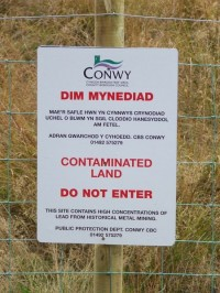 Contaminated land sign on minor road near to Llyn Bodgynydd. Photo by Keith Evans cc at sa 2.0