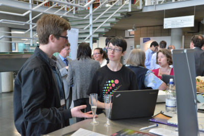 Photo of our Research Data Manager and a researcher chatting at the CORD launch event