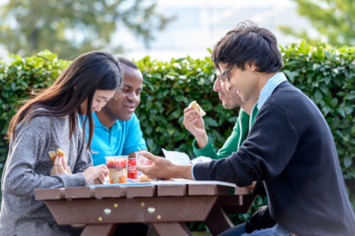 Students eating outside on Cranfield campus