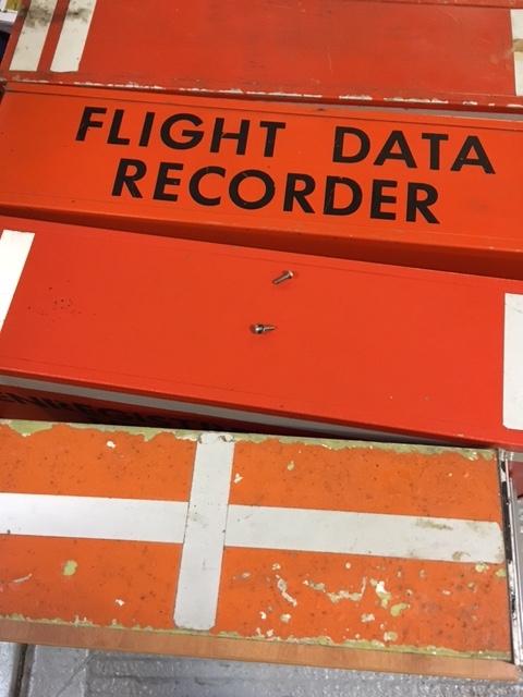 Photograph of an orange black box recorder