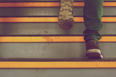 Photo of two legs walking up steps