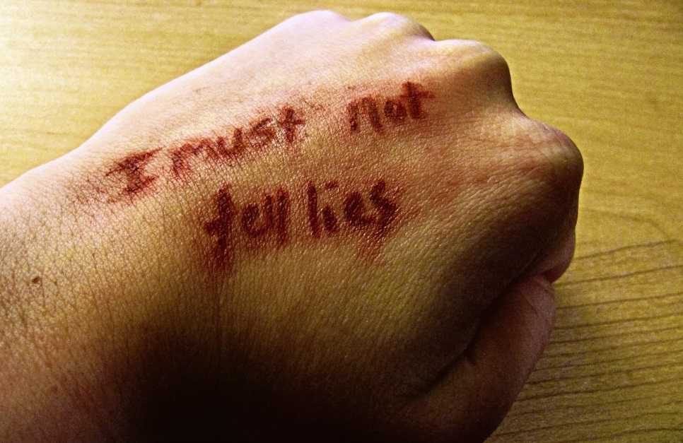 """""""I must not tell lies"""" written on a hand"""
