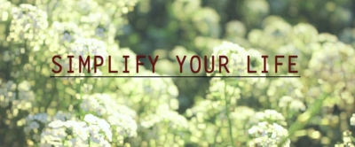 """Simplify your life"" written on a calming photo of white flowers"