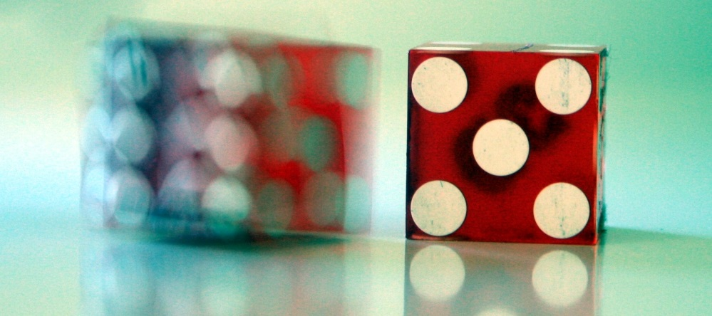 Photo of a dice showing the number five
