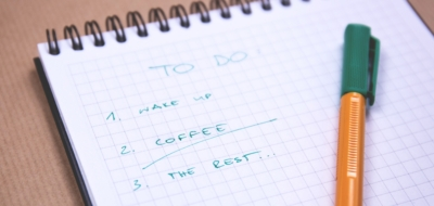 Photo of a notepad with a checklist on it highlighting 'coffee'
