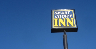 "Photo of a sign saying ""Smart Choice Inn"""