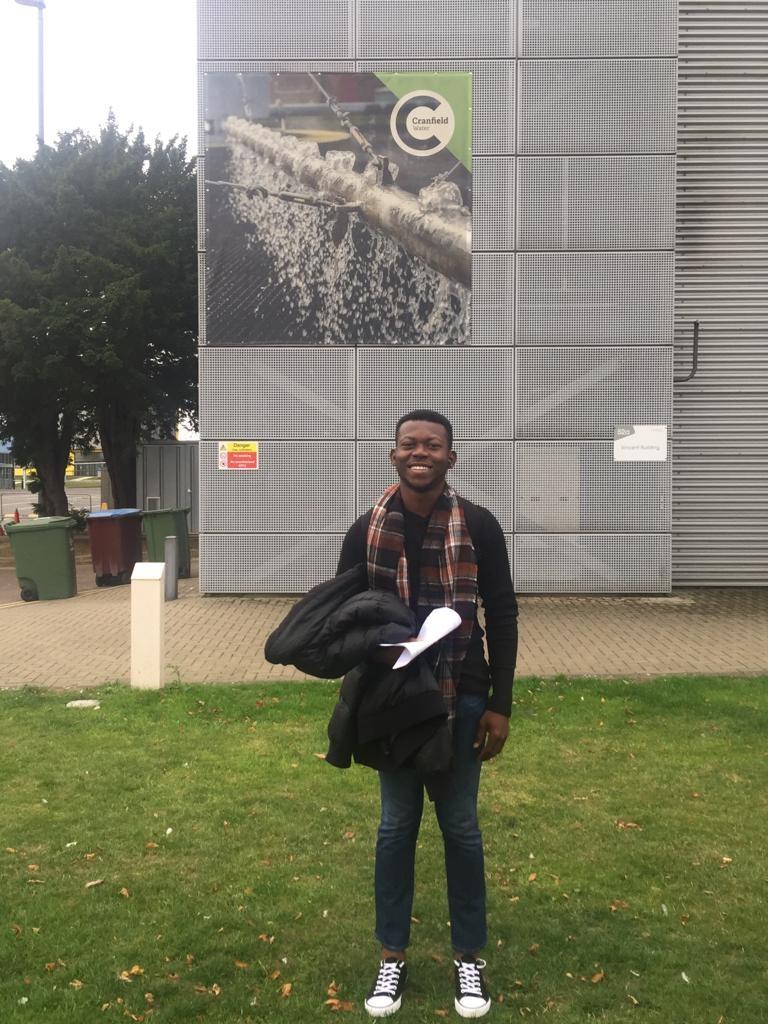 Daniel on campus outside the Vincent Building