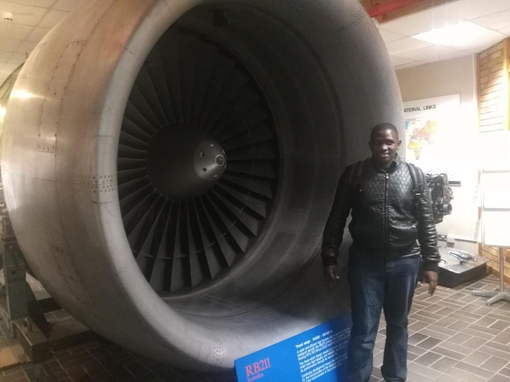 Jackson Makanga next to an RB211 Turbo fan