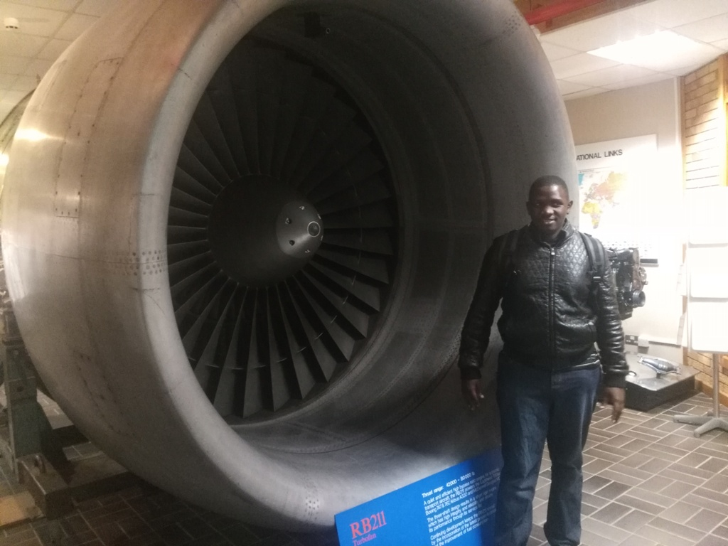 Jackson Makanga next to an RB211 Turbo fan
