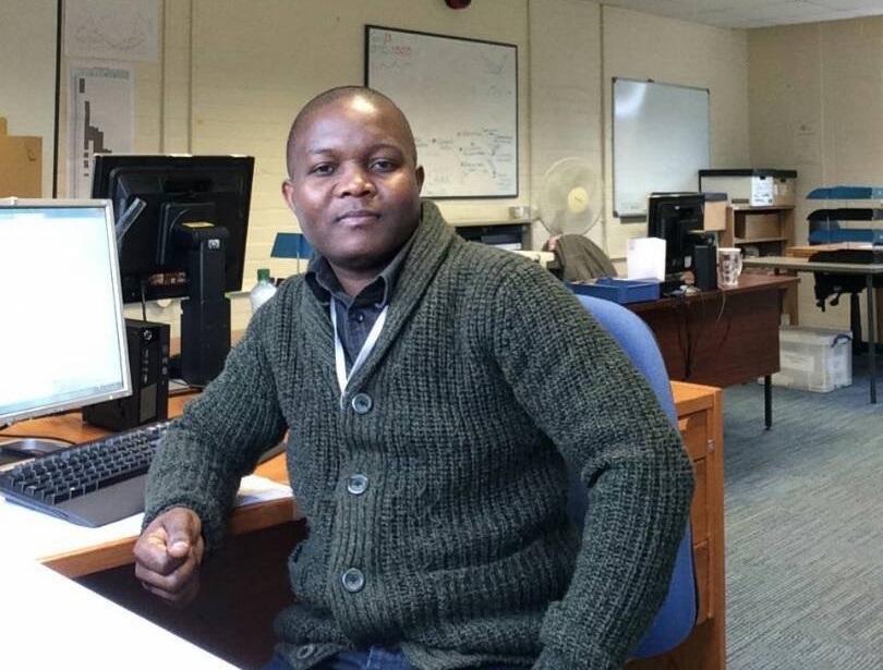 Photo of Antony Nyombi at an office desk