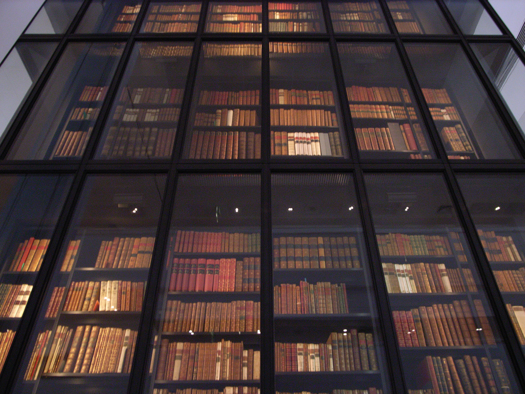 book stacks behind glass