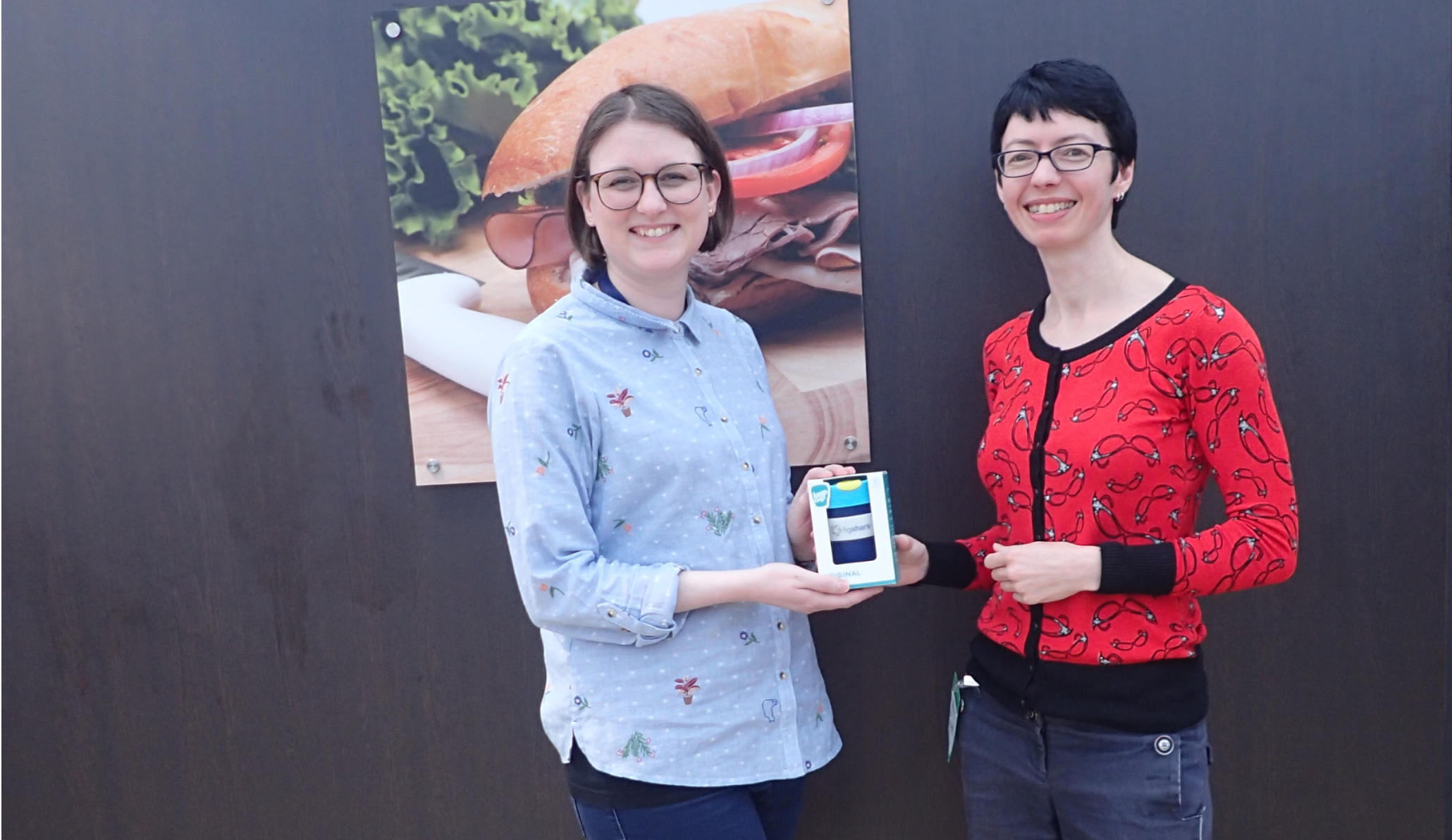 Photo of Georgina presenting Hannah with a figshare cup