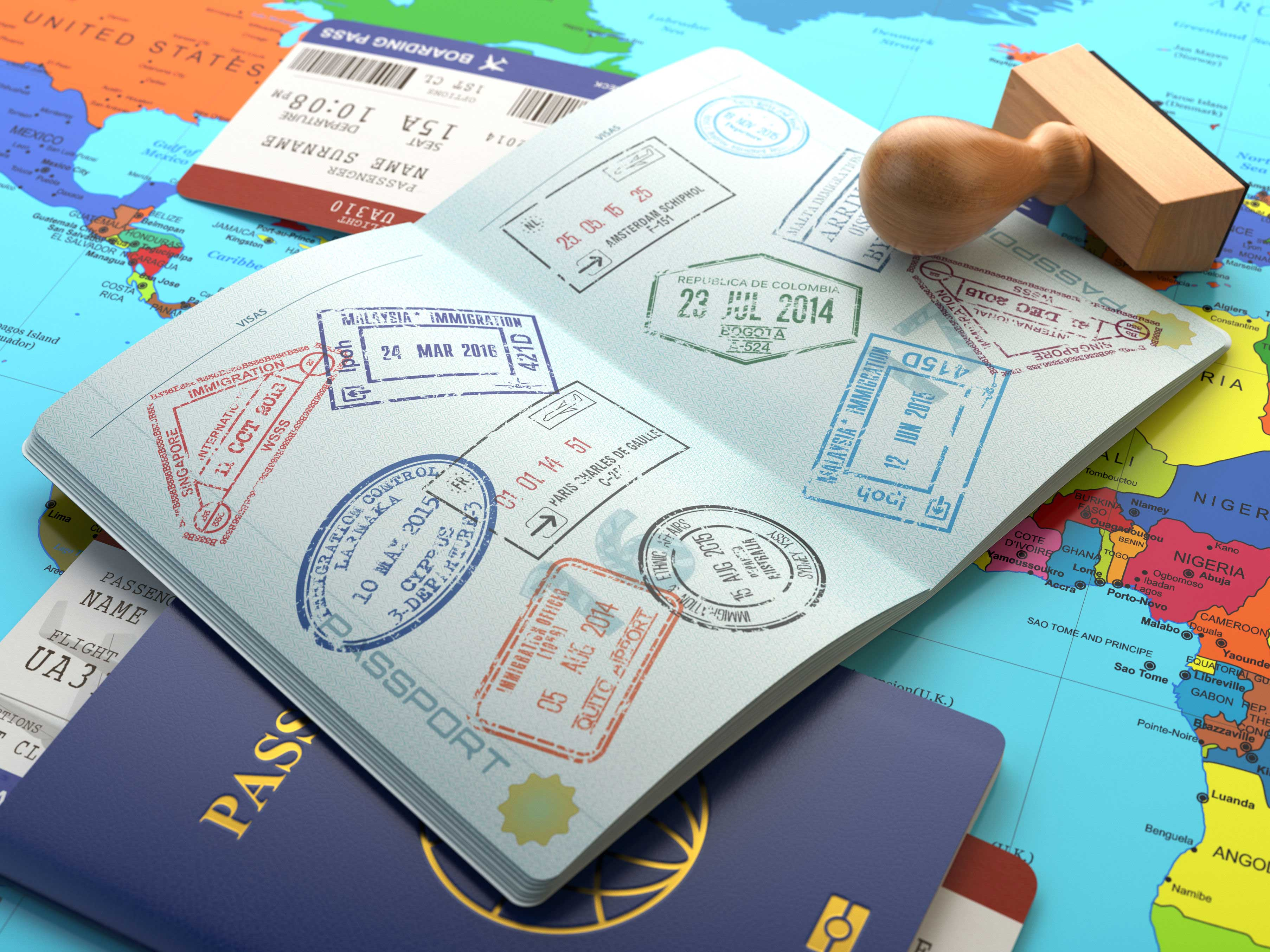 A stock image showing a passport with several stamps